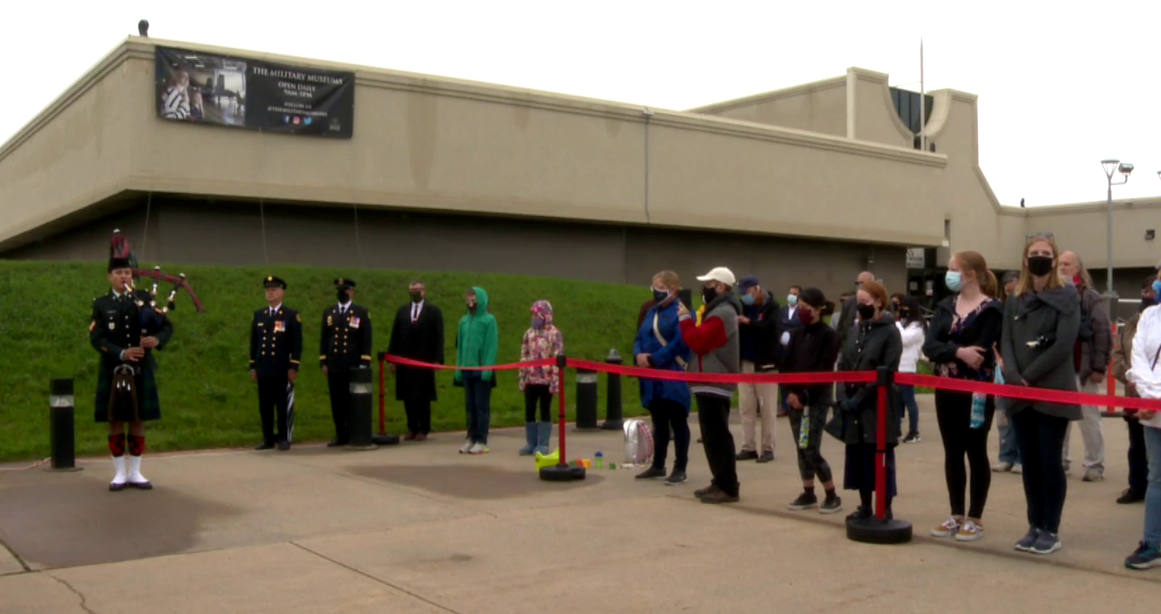 People commemorate the 20th anniversary of 9/11 at the Military Museums in Calgary on Saturday, Sept. 11, 2021.