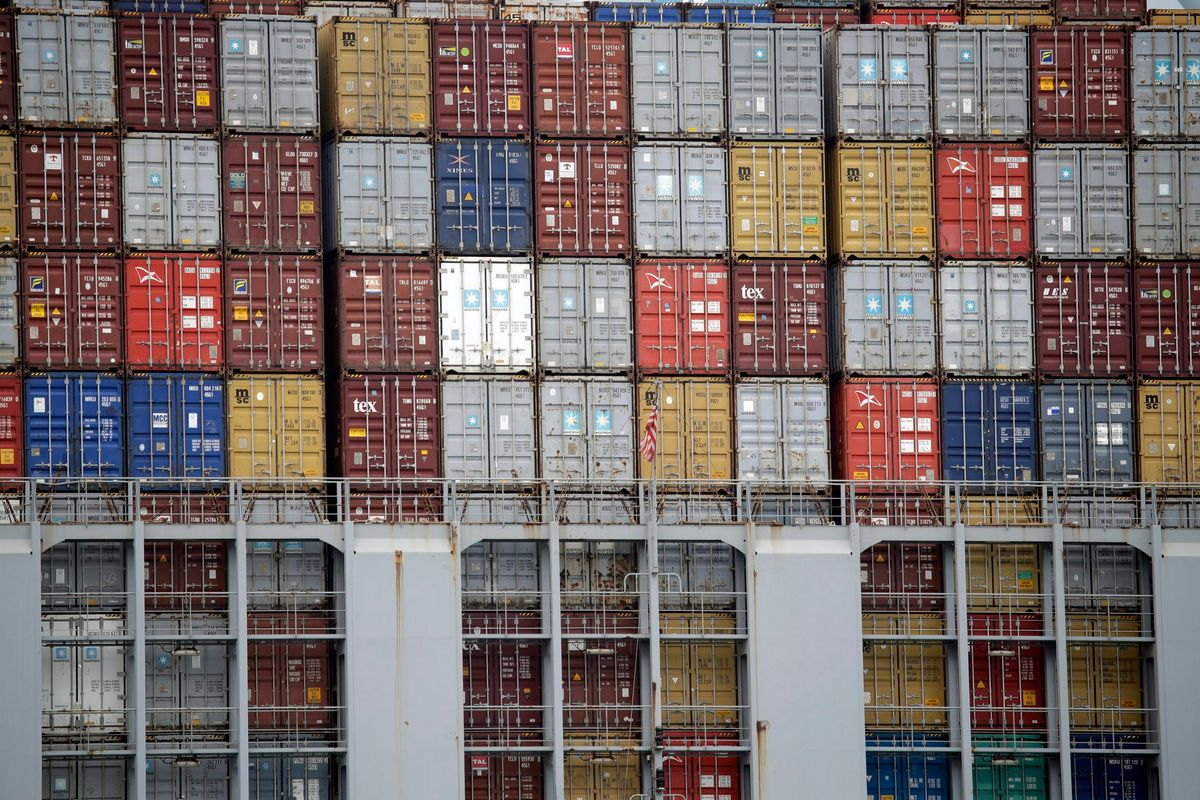 FILE - In this June 19, 2019, file photo cargo containers are stacked on a ship at the Port of Los Angeles in Los Angeles.