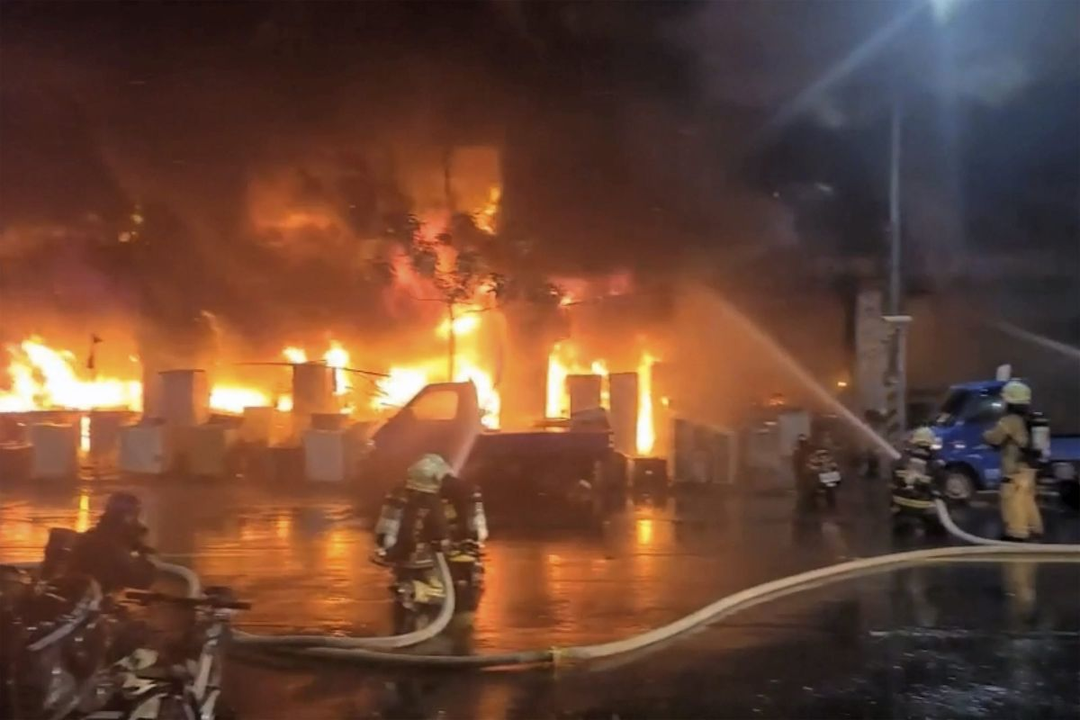 In this image taken from video by Taiwan's EBC, firefighters battle a blaze at a building in Kaohsiung, in southern Taiwan on Thursday, Oct. 14, 2021. The fire engulfed a 13-story building overnight in southern Taiwan, the island's semi-official Central News Agency reported Thursday. (EBC via AP ).