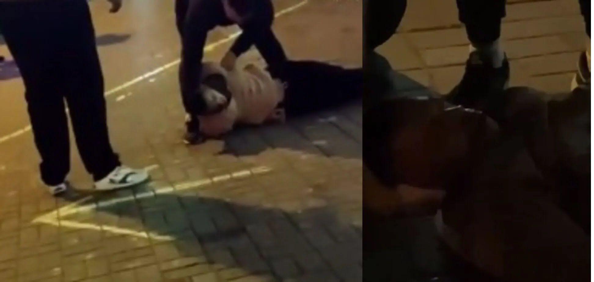 Парень лежал на земле.