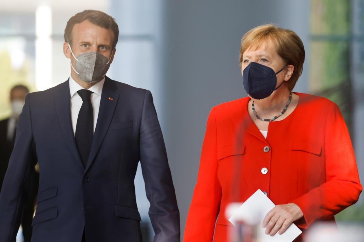 Анґела Меркель і Еммануель Макрон / фото REUTERS