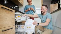 Man Carefully Times His Loading Of The Dishwasher So Wife Will See Him