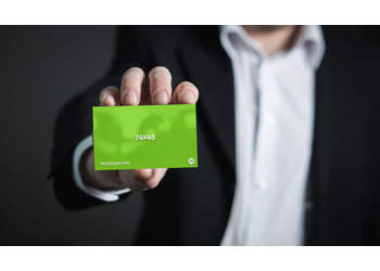 Business Card in hand | Mockuper.net