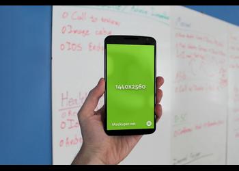 Nexus 6 in hand | Mockuper.net