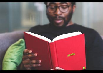 Guy in glasses reading | Mockuper.net