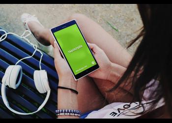 Woman in nature holding Nokia Lumia | Mockuper.net