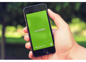 iPhone 5 in hand | Mockuper.net