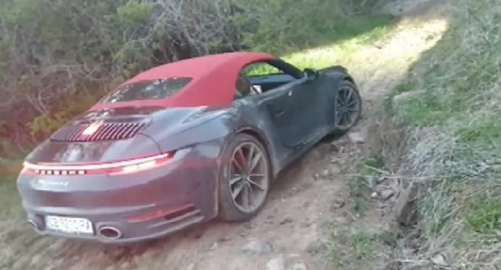 The Porsche 911 supercar was forced through the offroad terrain. Source: carscoops.com