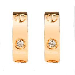 Jt Ατσάλινοι κρίκοι μεσαίοι ροζ χρυσοί 'θήτα' με κρύσταλλα 2cm