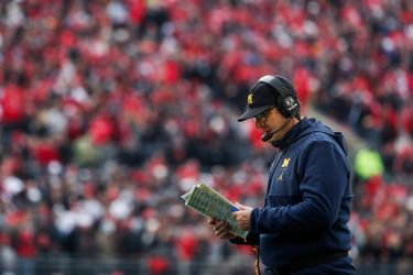 One inch has defined Jim Harbaugh's Michigan legacy. Now he must change it