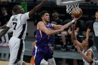 Phoenix Suns crush short-handed San Antonio Spurs in notching 50th win of season