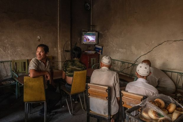 Uighurs watching a movie at a tea house in Xinjiang, China, on August 8th, 2019. Photograph: Gilles Sabrié/New York Times