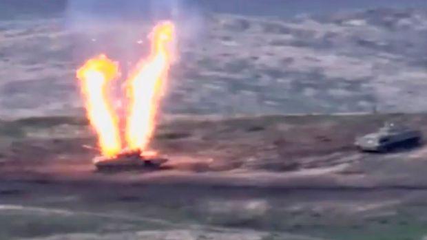 An Azeri armoured vehicle ablaze in Nagorno-Karabakh, the disputed region that boders Armenia and Azerbaijan. Photograph: EPA