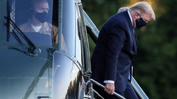 US president Donald Trump exits Marine One while arriving to Walter Reed National Military Medical Center in Bethesda, Maryland. Photograph: Oliver Contreras/EPA
