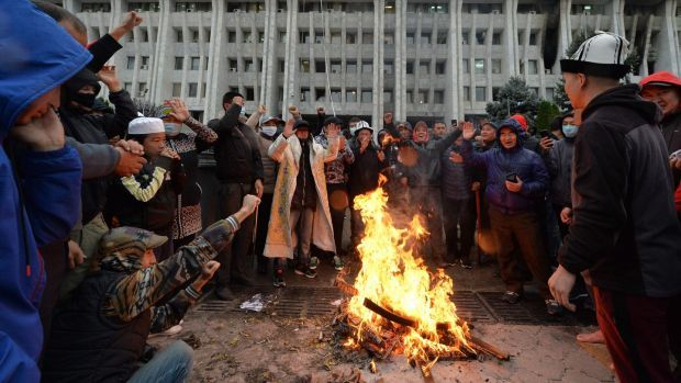 People protesting against the election results outside the government building in Bishkek. Photograph: Vyacheslav Oseledko/AFP via Getty Images