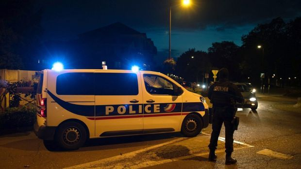 French police officers stand guard a street in Eragny on October 16th, where an attacker was shot dead by policemen after he decapitated a man earlier on the same day in Conflans-Sainte-Honorine. Photograph: Abdulmonam Eassa/AFP via Getty