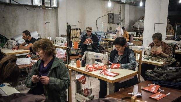 Sewing military uniforms and other supplies in a basement in Stepanakert, Nagorno-Karabakh, on October 15th. Photograph: Sergey Ponomarev/New York Times