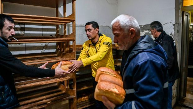 People receive free bread from a bakery in the city of Stepanakert, Nagorno-Karabakh, that reportedly runs 24 hours a day. Photograph: Aris Messinis/AFP/Getty