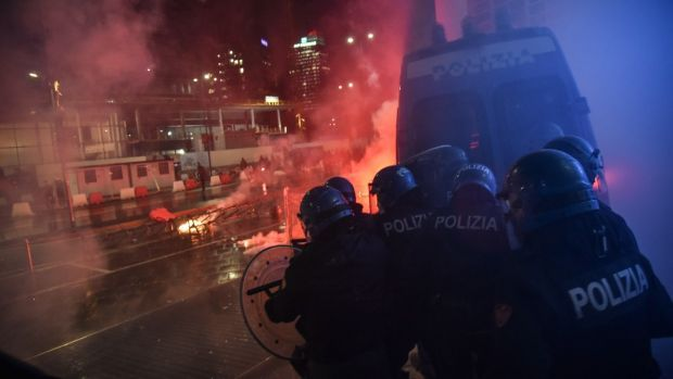 Clashes in Milan, Italy on Monday between demonstrators and police during the protest against the measures implemented to stop the spread of the Covid-19 pandemic. Photograph: Matteo Corner/EPA