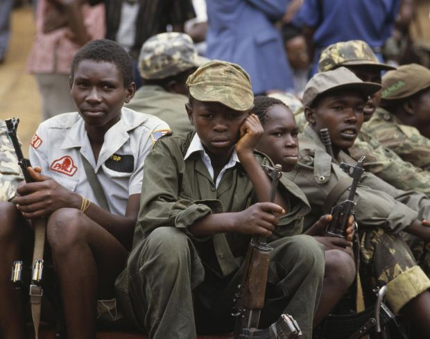 Child soldiers watch the inauguration of Yoweri Museveni in 1986. Photograph: William Campbell/Sygma via Getty