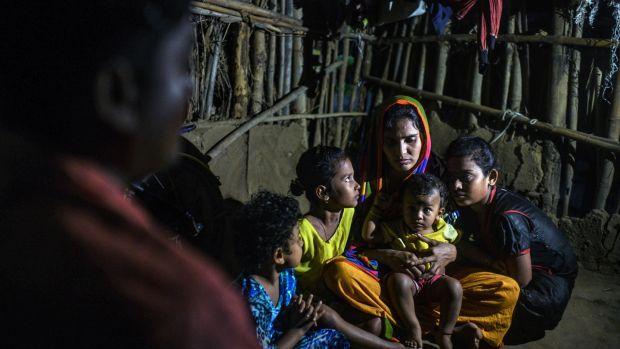 Rita Behera, the widow of Prafulla Behera, with their four daughters on Nov. 10th. Photograph: Atul Loke/The New York Times