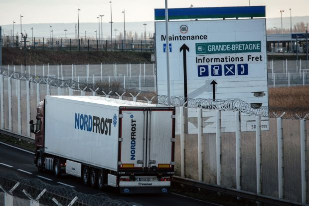 A refrigerated truck on an access road near the Euro Tunnel in Calais on New Year's Eve. Photograph: Cyril Marcilhacy/Bloomberg