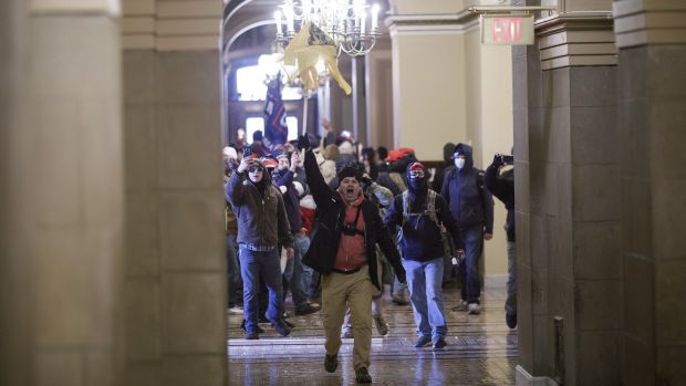 Demonstrators breaches barricades to enter the U.S. Capitol during a protest at the Ellipse in Washington. Photograph: Ting Shen/Bloomberg