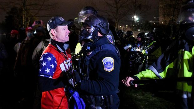 Police clear a mob of Trump supporters from the US Capitol grounds in Washington on Wednesday, January 6th. Photograph: The New York Times