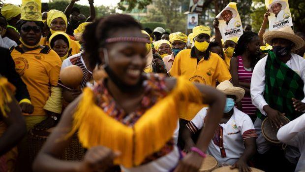 Supporters of president Yoweri Museveni celebrate in Kampala, Uganda on Thursday. Photograph: Luke Dray/Getty Images