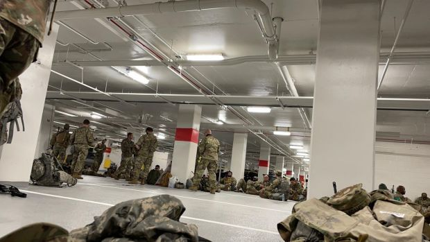 A photo provided to The New York Times shows National Guard soldiers resting in the parking garage of the Thurgood Marshall Federal Judiciary Building in Washington on Thursday. Photograph: New York Times