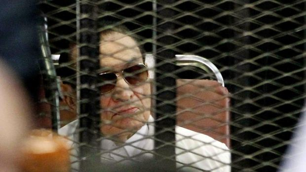 Former Egyptian president Hosni Mubarak behind bars during his retrial in 2013. File photograph: Getty Images