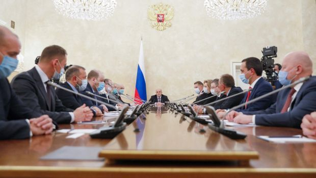 Russian prime minister Mikhail Mishustin (C) chairs a meeting of the bureau of the governmental board on vaccines against Covid-19, in Moscow on Saturday. Photograph: Dmitry Astakhov/Sputnik/AFP