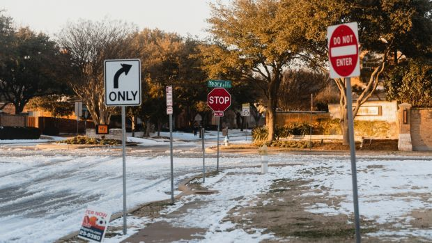 The corner of Clark Parkway and Yeary Road in Plano, Texas, where Bob Manus worked as a crossing guard. He died of the coronavirus in January. Photograph: Zerb Mellish/New York Times