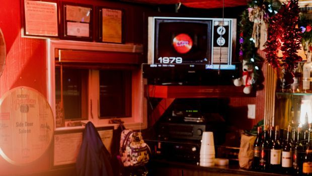 The Side Door Saloon in Petoskey, Michigan. Larry Cummings, who died of Covid-19 in March at the age of 76, liked to visit the bar after work on Mondays. Photograph: Lyndon French/New York Times