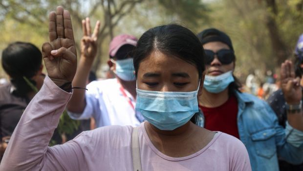 People flash a three-finger salute at the funeral of Ma Kyal Sin, a teenage protester shot dead by security forces, in Mandalay on Thursday. Photograph: Kaung Zaw Hein