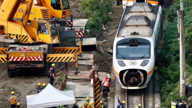 Rescue workers assist after a train derailed in north of Hualien, Taiwan, which was carrying almost 500 passengers. Photograph: Ritchie B Tongo/EPA