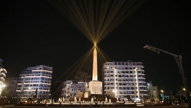 The Obelisk of Ramses II (surrounded by the recently-unveiled and restored four ancient sandstone sphinxes extracted from the Avenue of the Sphinxes in Luxor) in the centre of the main roundabout of Tahrir Square. Photograph: Getty