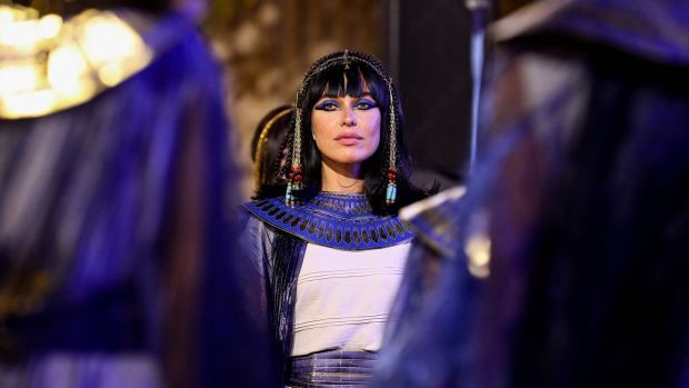 A performer dressed in ancient Egyptian costume awaits the start of the parade of ancient Egyptian royal mummies departing from the Egyptian Museum in Cairo's Tahrir Square. Photograph: Getty
