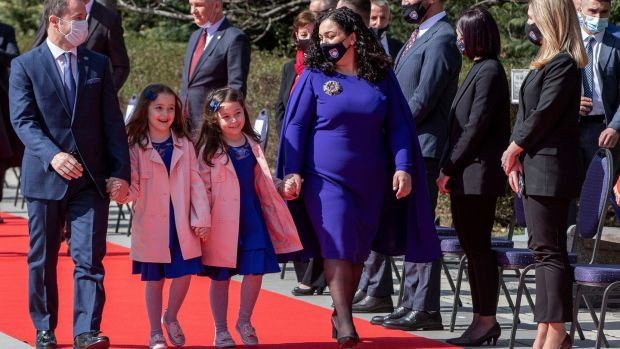 Kosovo's newly elected president, Vjosa Osmani, with her husband and their twin daughters attend the presidential handover ceremony. Photograph: Visar Kryeziu/AP Photo