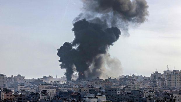 Smoke billows following an Israeli air strike on targets in Gaza City. Photograph:Mahmud Hams/AFP/Getty