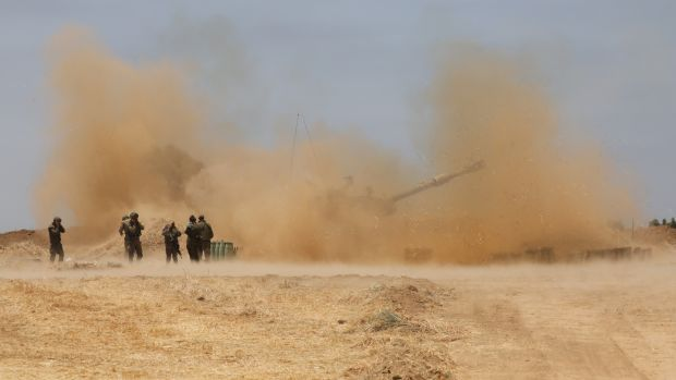 Israeli artillery in action as the escalation continues between Israeli army and Hamas at the Gaza Border. Photograph: Abir Sultan/EPA