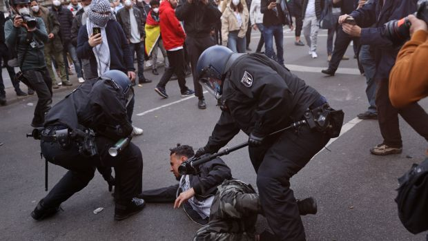 Police detain a man during a march by protesters to demonstrate for the rights of Palestinians on Saturday in Berlin. Photograph: Sean Gallup/Getty Images