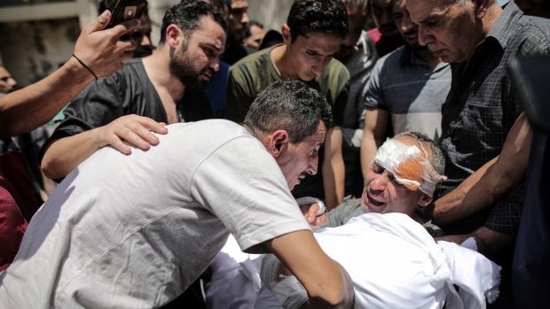 Raed Ishkontana, who survived an Israeli air strike, mourns the loss of five family members including four children in Gaza City on May 16th. Photograph: Hosam Salem/New York Times