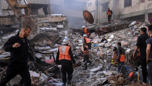Rescue workers search for victims from the al-Qawlaq family after an Israeli air strike in Gaza City on May 16th. Photograph: Samar Abu Elouf/New York Times