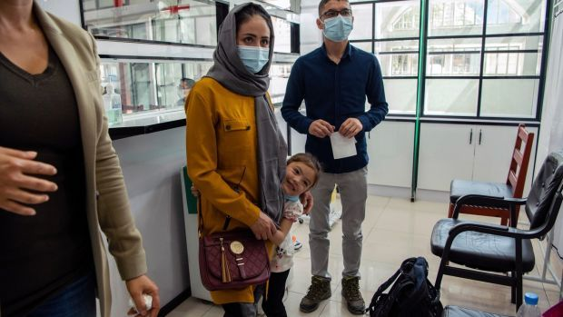 Afghan air force Maj Naiem Asadi, his wife, Rahima, and their daughter, Zainab, arrive for coronavirus testing at a clinic in Kabul on May 31st, the day before their departure from Afghanistan. Photograph: Kiana Hayeri/The New York Times