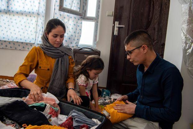 Afghan Air Force Maj Naiem Asadi, his wife, Rahima, and their daughter, Zainab, pack their bags in Kabul on May 31st. Photograph: Kiana Hayeri/The New York Times