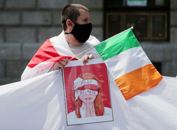 Members of the Belarusian community take part in a protest outside the GPO in Dublin, in support of political prisoners including Roman Protasevich. Photograph: Niall Carson/PA Wire