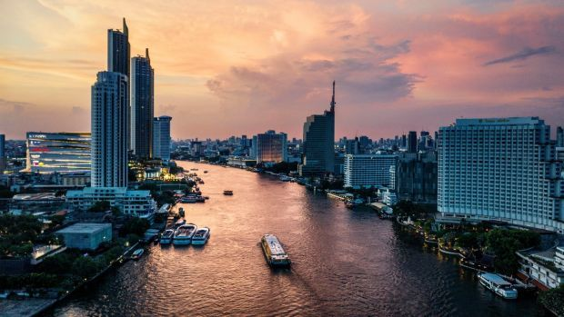 The Chao Phraya River, which flows past some of the Bangkok's five-star hotels. Photograph: Adam Dean/The New York Times
