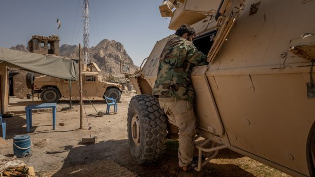 An Afghan soldier at an outpost in Panjwai, Afghanistan. Photograph: Jim Huylebroek/The New York Times
