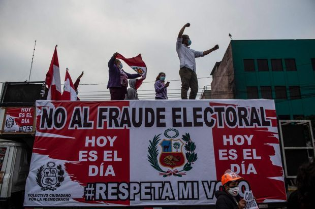 Supporters of the candidate for the Fuerza Popular party, Keiko Fujimori, protest in front of the National Organism of Electoral Processes building in Lima, on June 9th. Photograph: Ernesto BenavideS/AFP via Getty